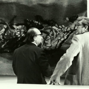 Admiring tapestries exhibited by students during the exhibition, Dresden, Germany, 1977